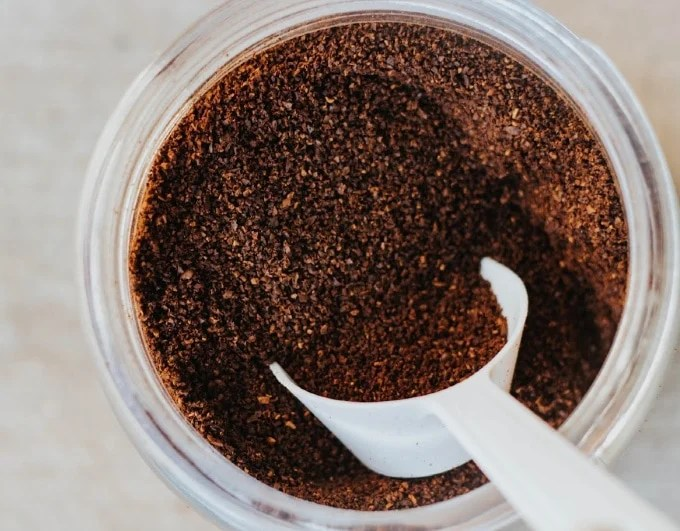 used coffee grounds being used to reduce food waste