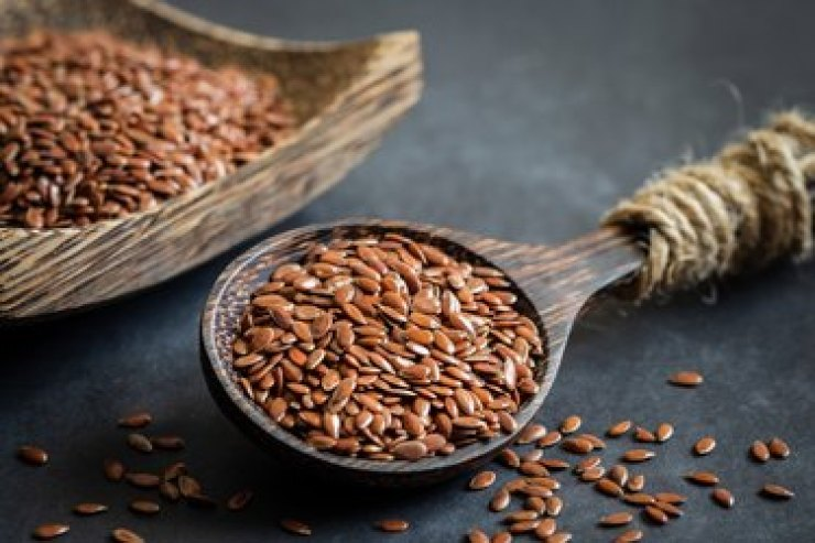 Flaxseed rich in magnesium on wooden spoon