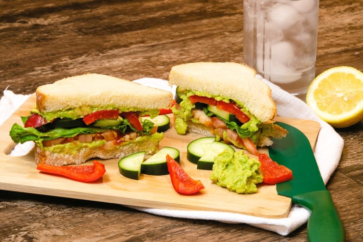 The ultimate veggie sandwich recipe with smashed avocado.  Without dairy products, vegan and with a fresh selection of whole grain bread and topping options.