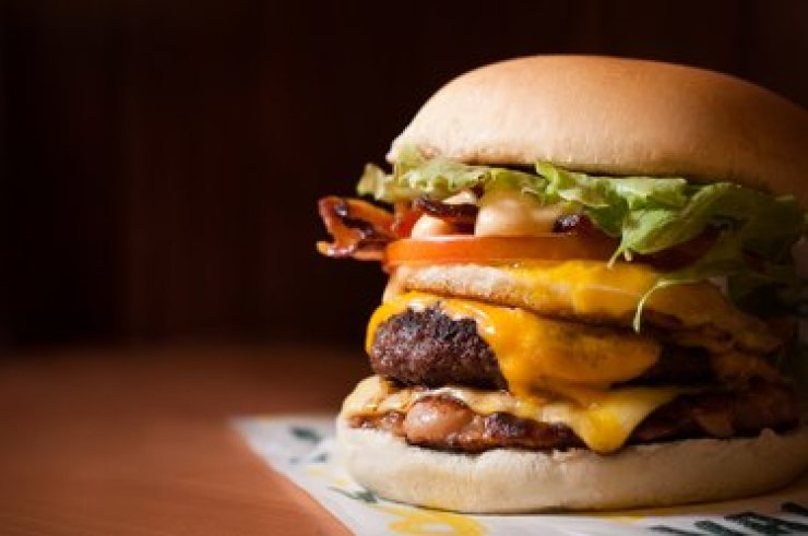 Close up of a fast food cheeseburger with bacon