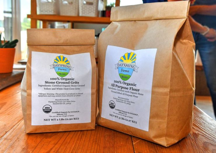 Two products from DaySpring Farms are Stone Ground Grits (2 pounds) and All Purpose Flour (5 pounds).  The smaller bags are intended for the home cook, while the 50 pound bags are more likely to be used by large bakeries and restaurants.  DaySpring Farms is an organic certified farm that grows, harvests and grinds grain on site.  (Chris Hunt for The Atlanta Journal-Constitution)
