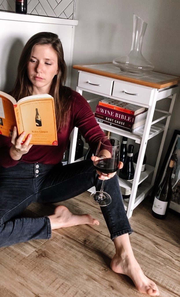 girl reading book with wine