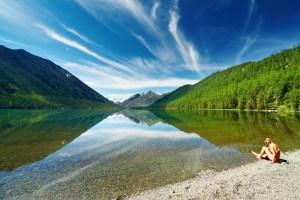 woman alone by lake