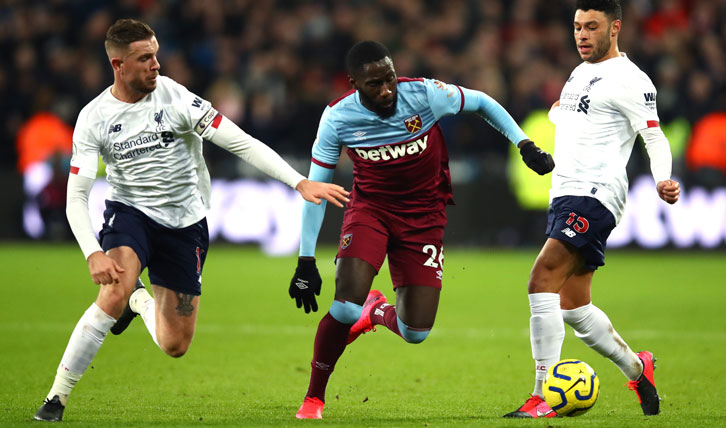 Arthur Masuaku in action against Liverpool