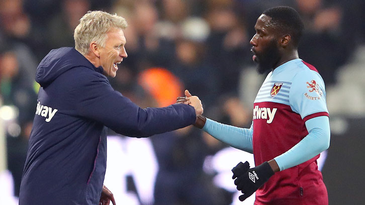 Arthur Masuaku shakes hands with manager David Moyes