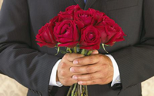 Image result for picture of a man holding roses