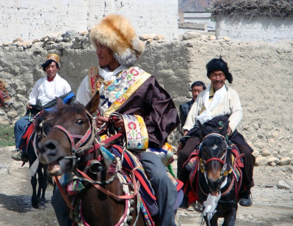 Horse riders showcase their horse mastery skills during the Yarthung Festival