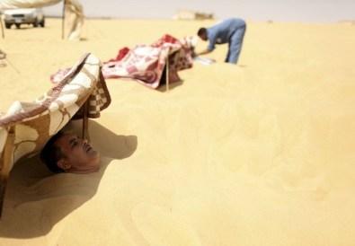 Photo of how Siwa sand baths are done via the web