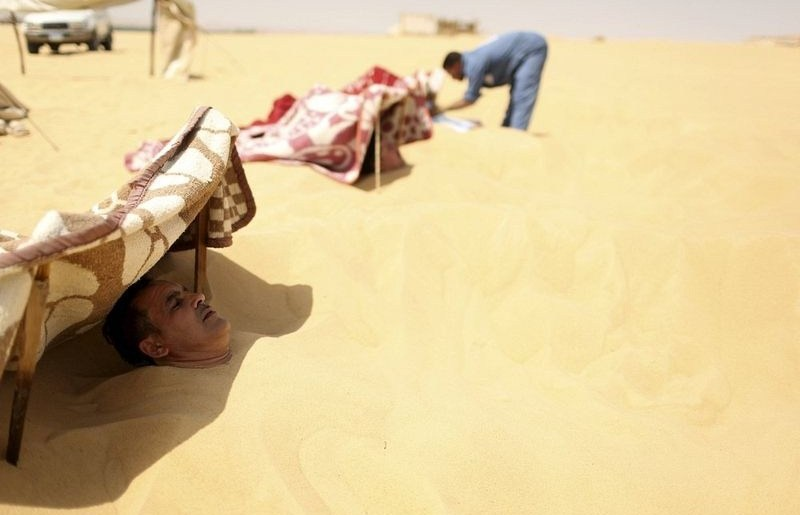 Photo of how Siwa sand baths are done via the web