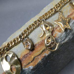 Brass Masquerade Charm Bracelet