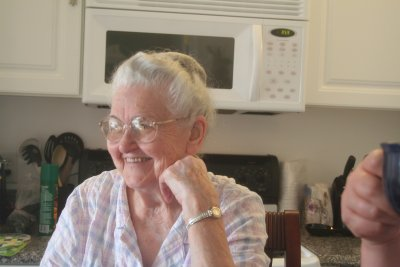 Mamaw laughing at her daughters over breakfast