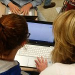 Boyle County High School Teacher Helps a Student with Technology during Class