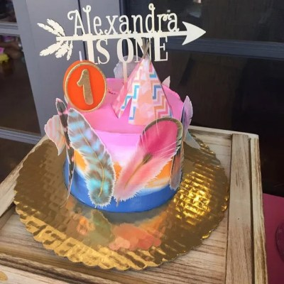 Wickstead's-Customer-Photo-of-our-Custom-Coloured-Feathers-with-Gold-Detailing-on-a-Colourful-First-Birthday-Cake