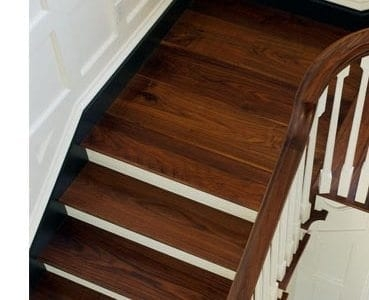 Design Ideas For Stairs To Match Your Custom Hardwood Floors | Dark Wood Stair Treads | Timber | White Handrail | Dark Stained | Natural Wood | Wood Finish