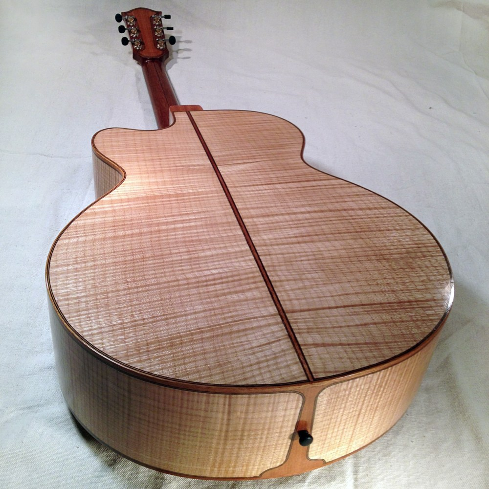 Flame Maple back of the P185, a replica of the Gibson J185 with a Venetian cutaway.