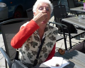 Mom enjoying a herring on the Cronje Straat, Haarlem