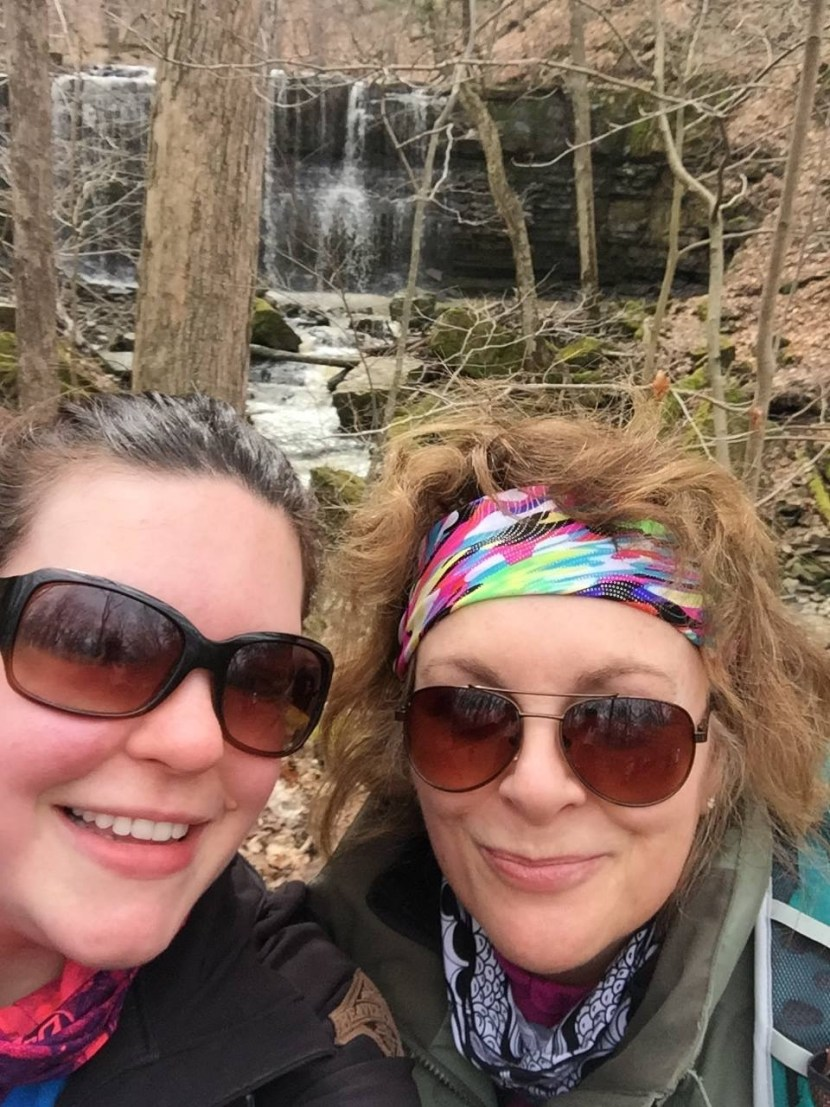 Miss J and I as foreground to the beauty of the falls.