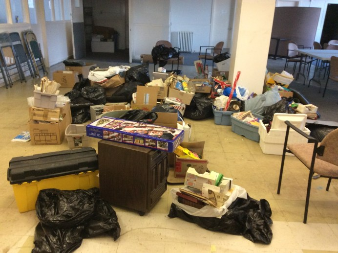 Using the main floor of the building as a staging area to sort through boxes and bags from the basement. Nearing the end...