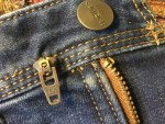 There is usually a stopper at the top of each side of the zipper chain.