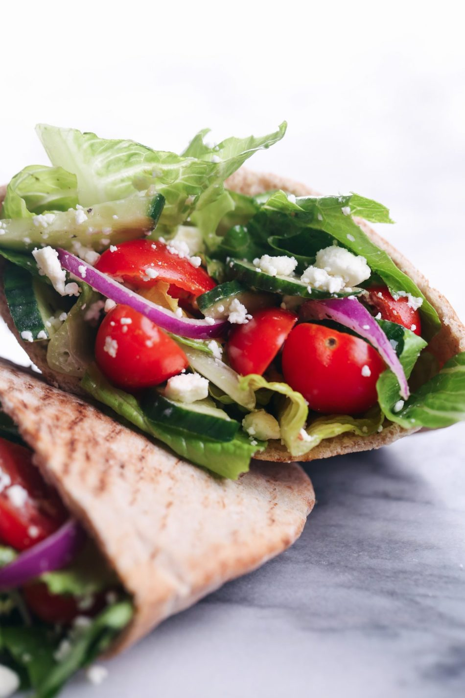 Greek Salad Stuffed Pitas | Vegetarian friendly with only a few ingredients.