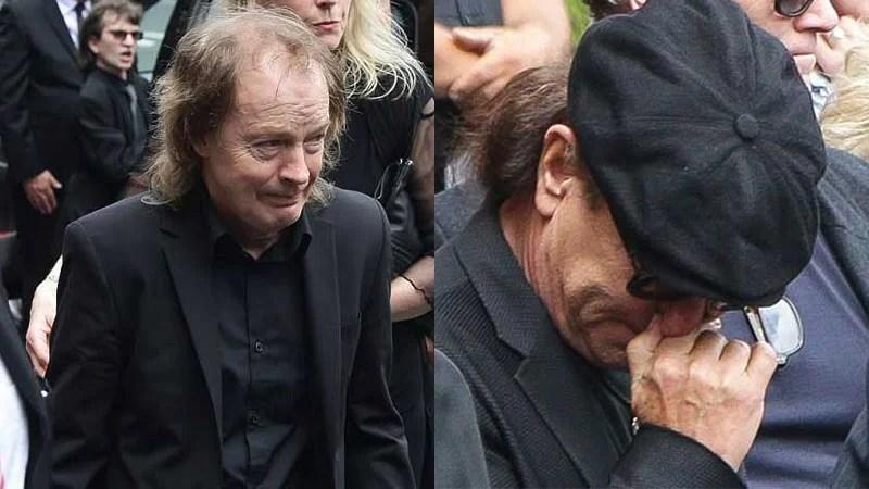 Angus Young e Brian Johnson do AC/DC no funeral de Malcolm Young