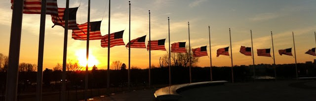 american flags at half staff