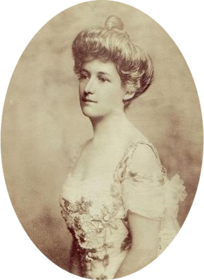 Lucile Polk Carter in a sepia photo wearing a pretty dress and her hair in a bun.