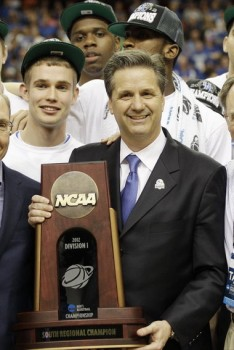 John Calipari and NCAA Trophy - photo by David J. Phillip | AP