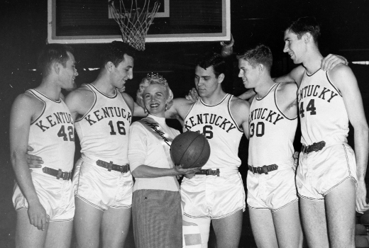 Lou Tsioropoulos (16), Cliff Hagan (6), Frank Ramsey (30), Phil Grawemeyer (44), and Bill Evans (42) pictured with Madge Barnett