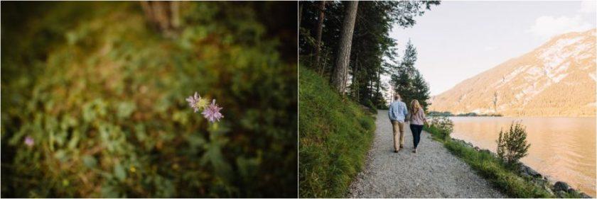 Couple walking along the shore of the lake