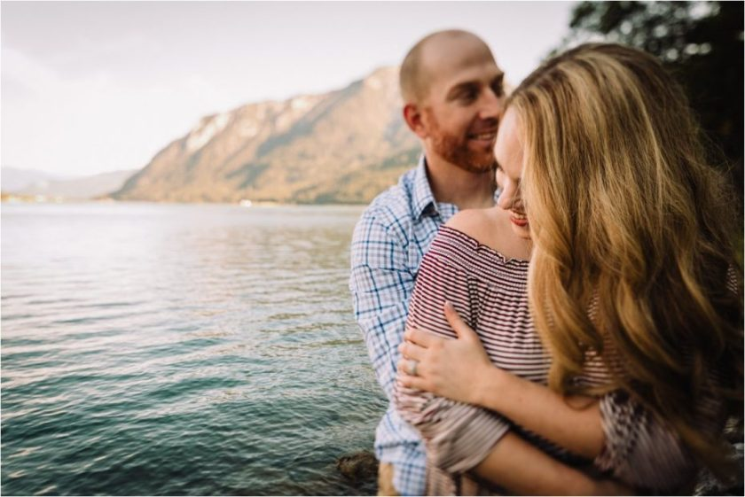 Close up of couple hugging by the lakeside