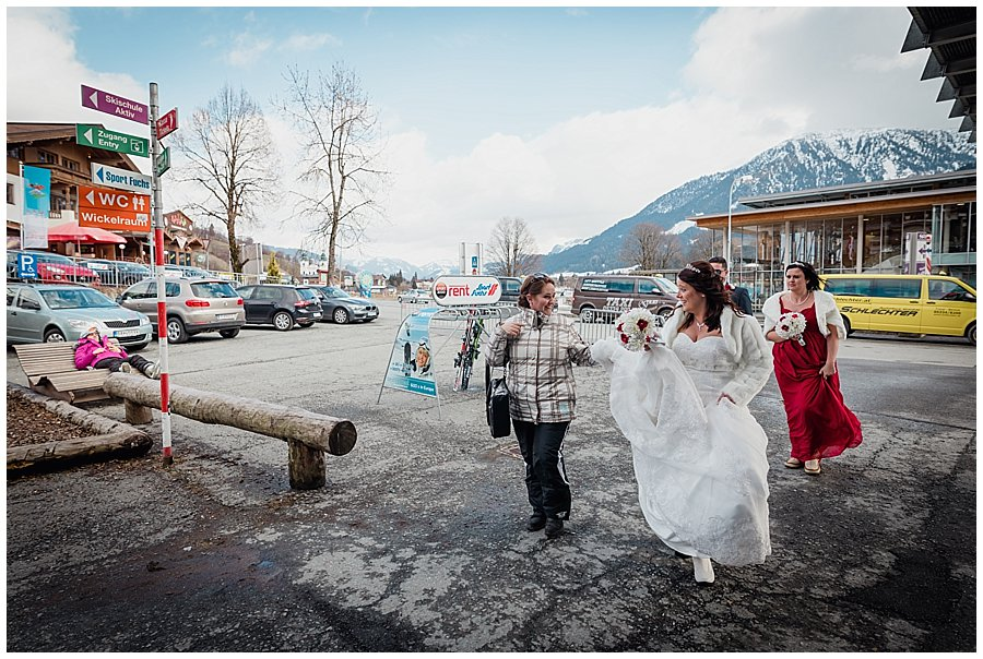 The bride Michelle with wedding planner Stephanie walking to the ski lift in Brixen