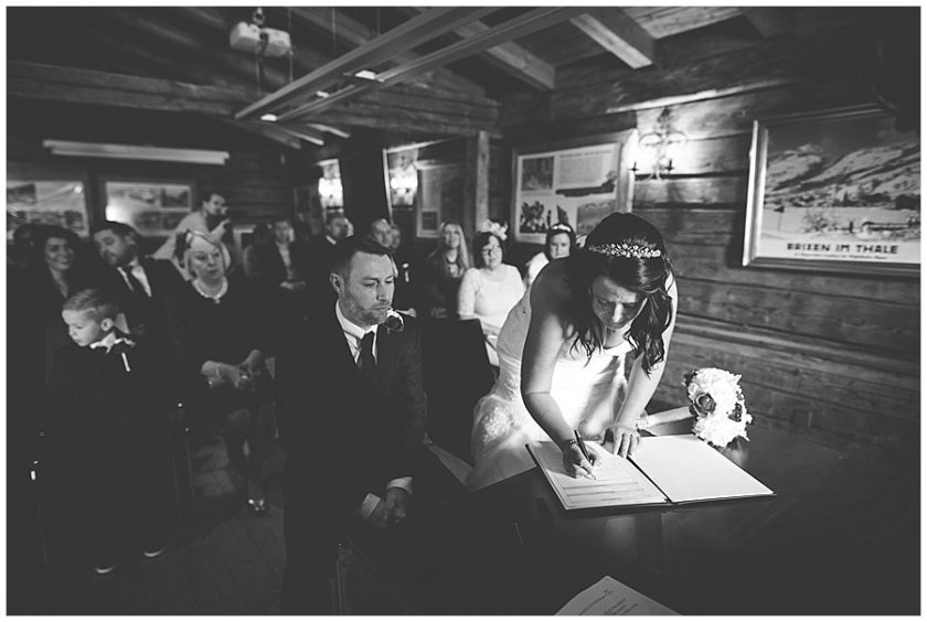Michelle signs the marriage register