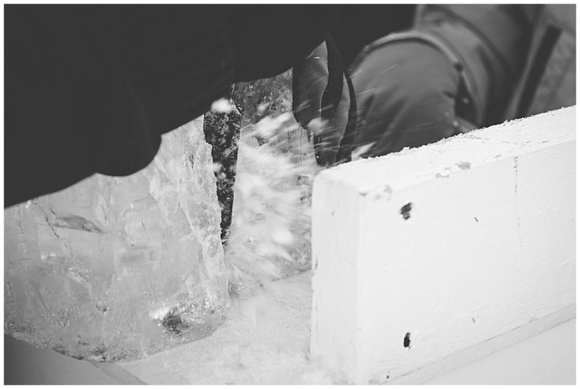 Close up of ice flakes flying off as a chisel hits the ice