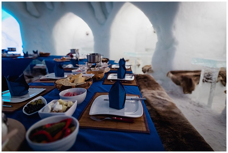 Igloo wedding dinner - Bread, meat and cheese in bowls ready for the fondue dinner by Wild Connections Photography