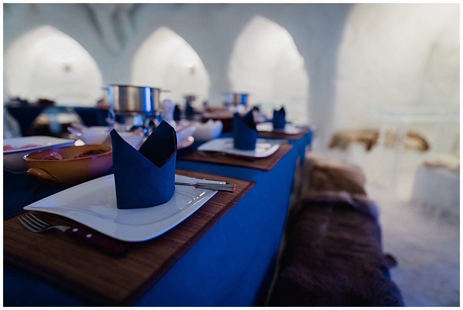 Blue table decorations for the igloo wedding breakfast