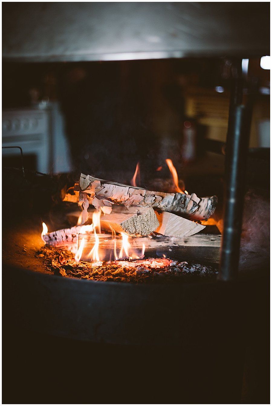 A log fire in the kota to warm up in Levi Finland by Wild Connections Photography