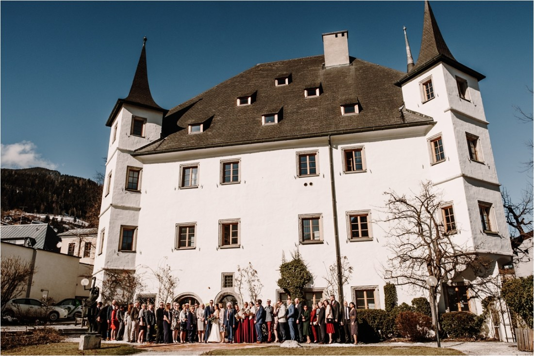 Wedding group photo outside the Rathaus in Zell Am See by Wild Connections Photography