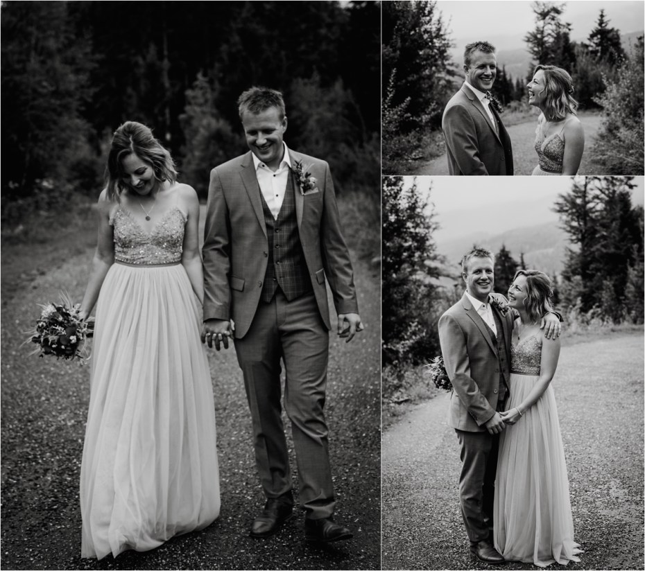 The bride and groom walk along a mountain path laughing and smiling by Wild Connections Photography