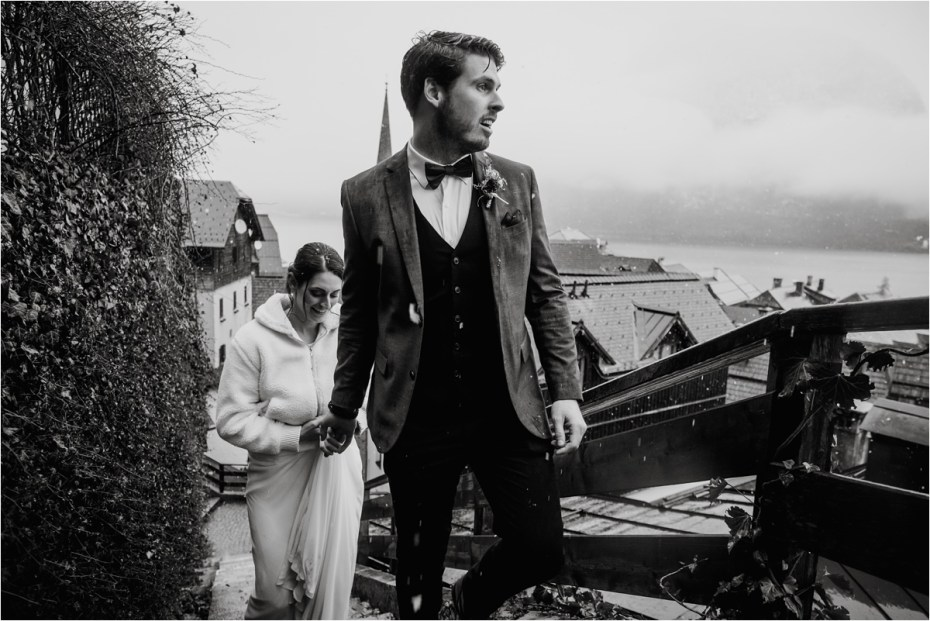 Bride and groom walk up the stairs in Hallstatt on their wedding day. Photos by Wild Connections Photography