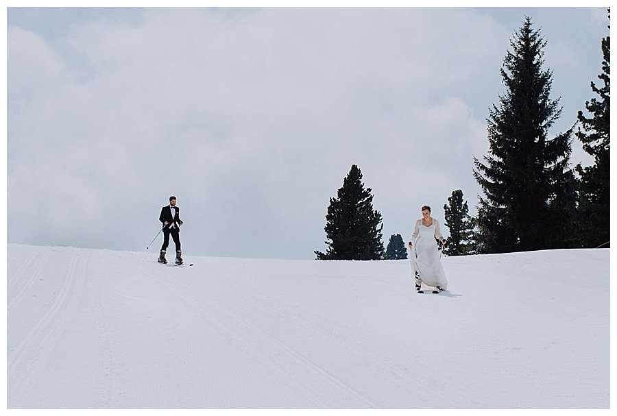 Bride & Groom on skis take to the nursery slopes in Austria
