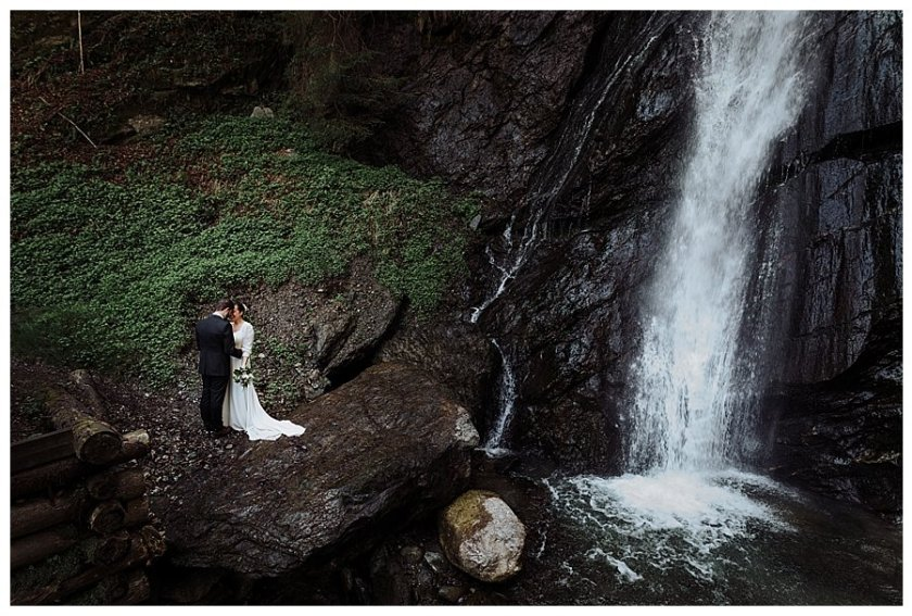 Susana and Tiago standing at the base of a waterfall