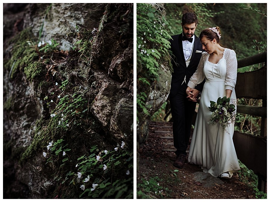 The bride leads the groom down a forest path