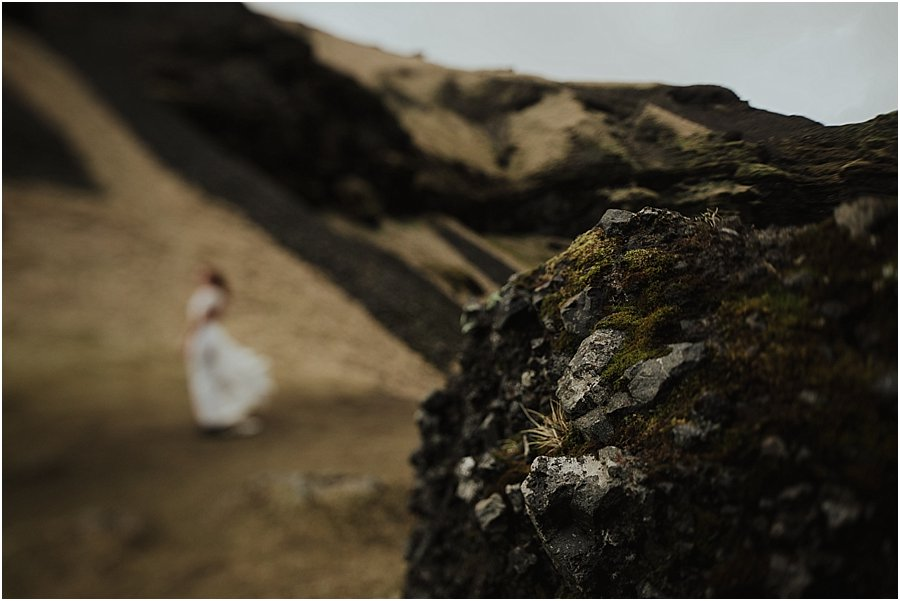 Close up of a rock with a bride in the distance