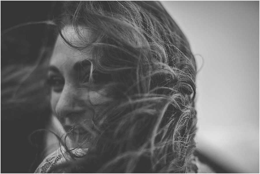 The bride's hair blowing across her face