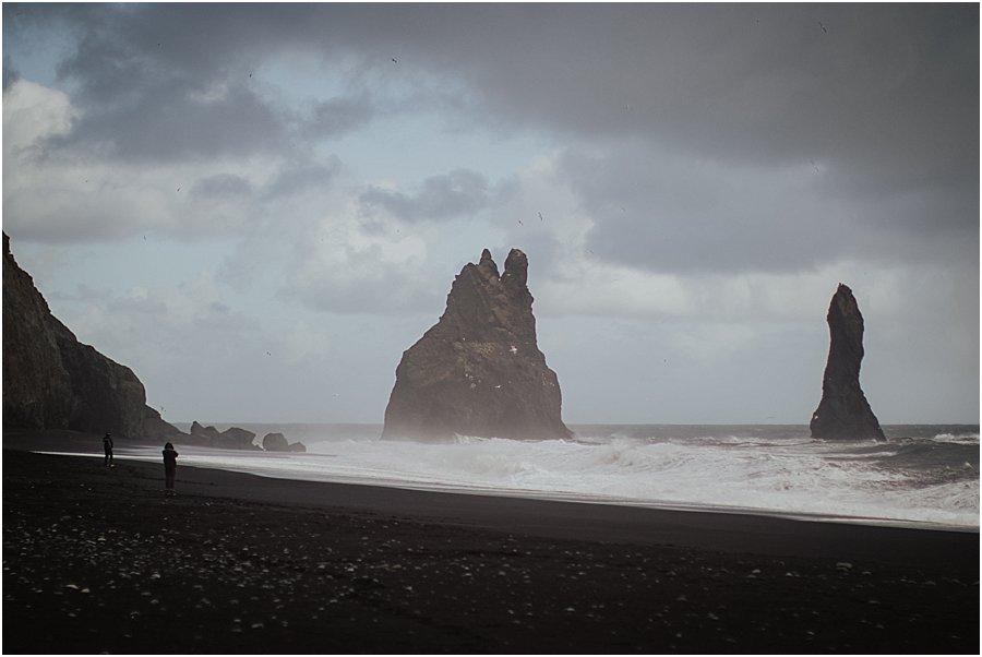 Towing rock pillars on the black beach