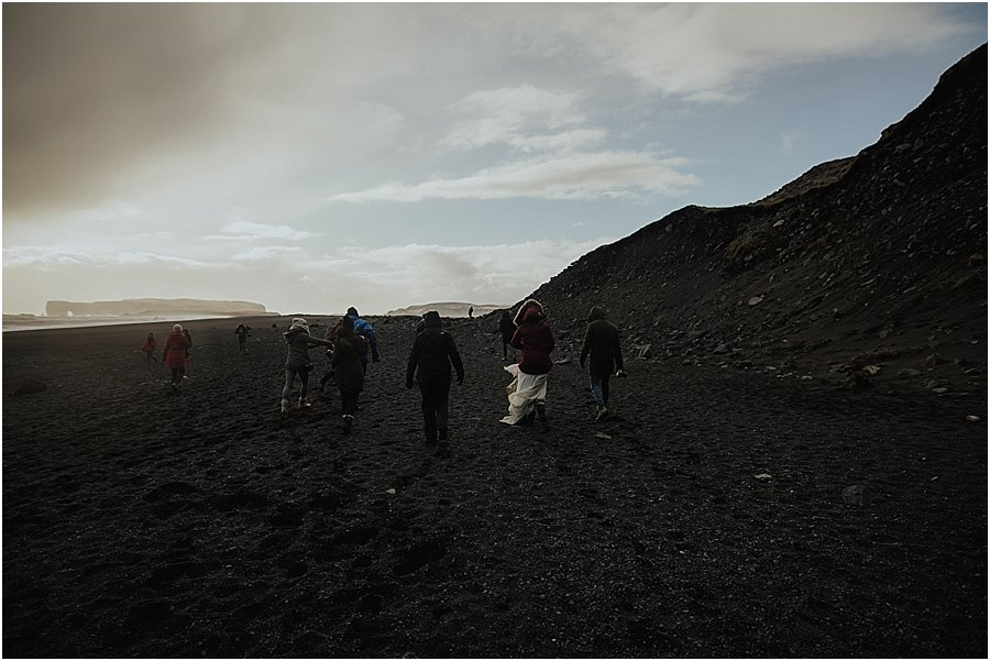 Group of people walking away from the camera