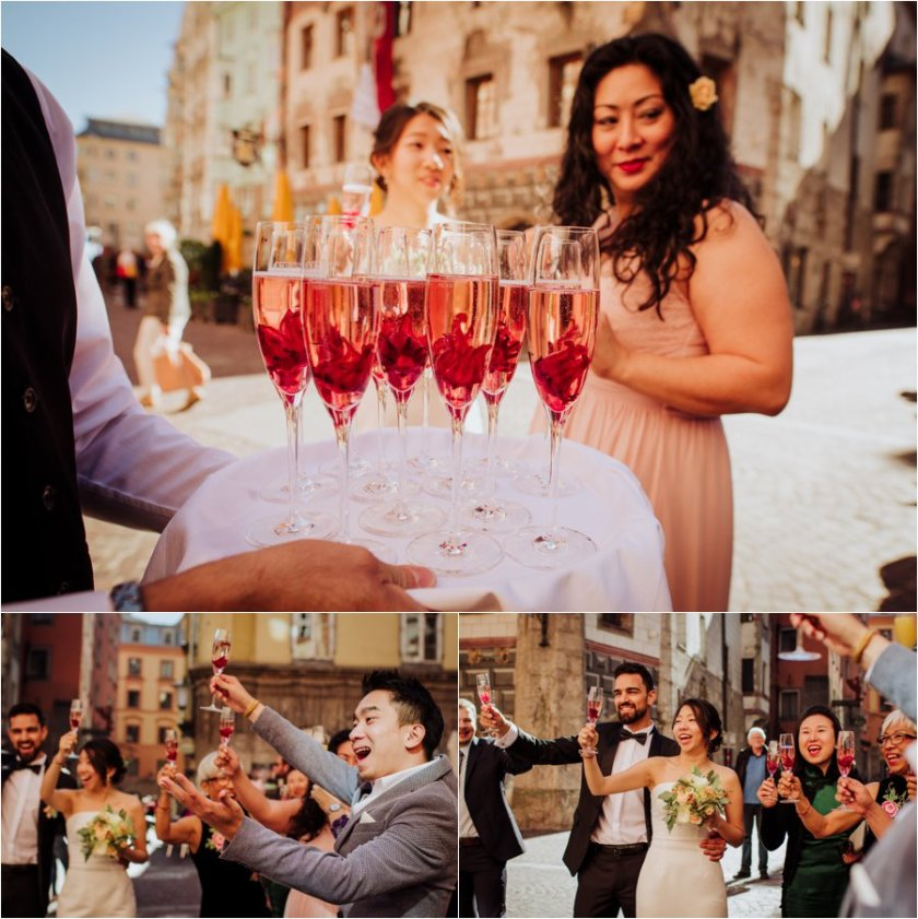 Prosecco to toast outside the Ottoburg in Innsbruck old town by Wild Connections Photography