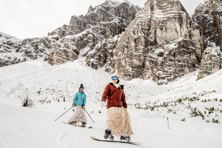 A skiing and snowboarding bride in the Alps by Wild Connections Photography