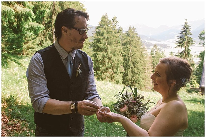 St Johann in Tirol Elopement Chris places the ring on Nikki's finger by Wild Connections Photography